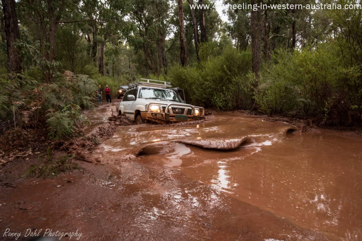 Nissan Patrol In Mud Barrel.
