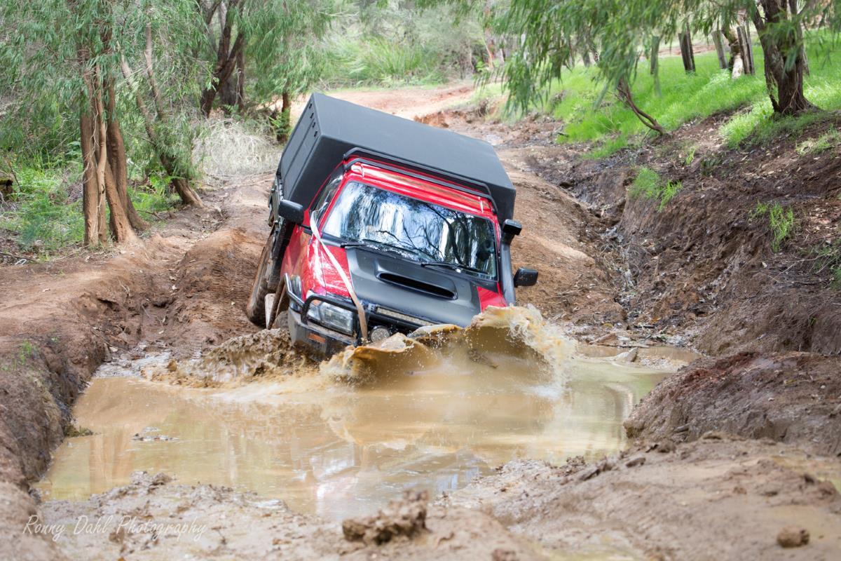 Nissan GU Patrol takes on a mud hole.