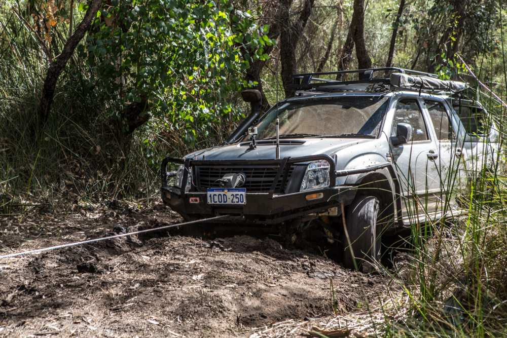 Holden Rodeo winching out of a bog hole.