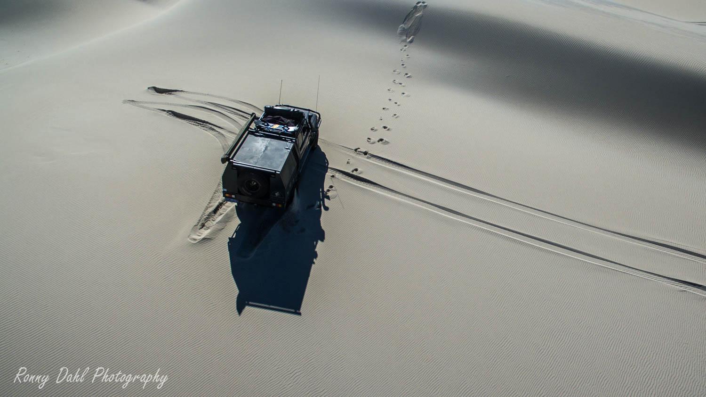 79 series Land Cruiser on a sand dune.