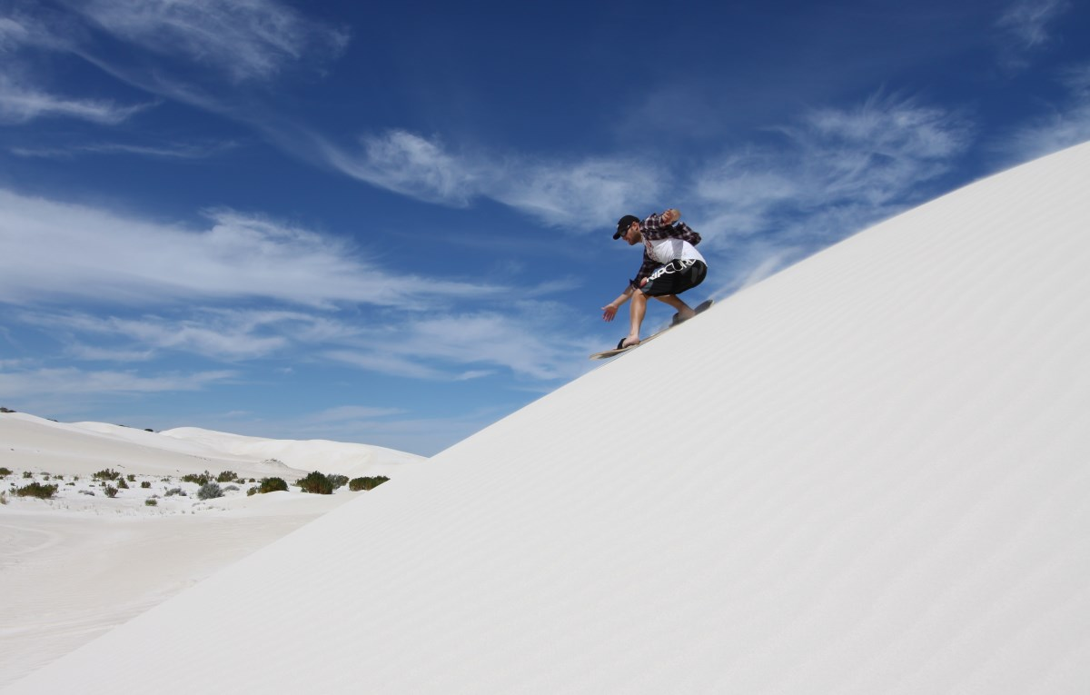 Sand boarding at Lancelin, Western Australia.