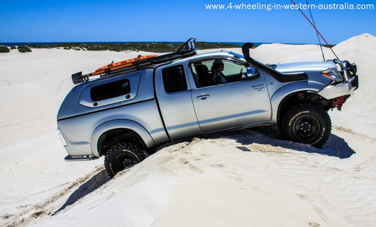A 4x4 is stuck on a razor back dune.