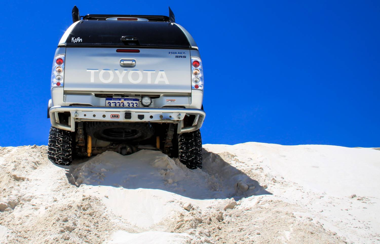 Toyota Hilux stuck on a razor back dune.