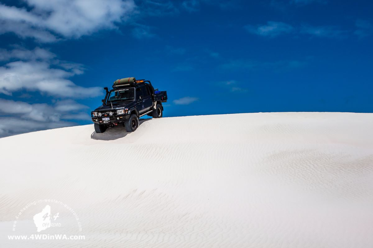 79 Series Land Cruiser on a sand dune.