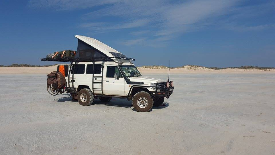 The Toyota Landcruiser Troopy on a salt lake.