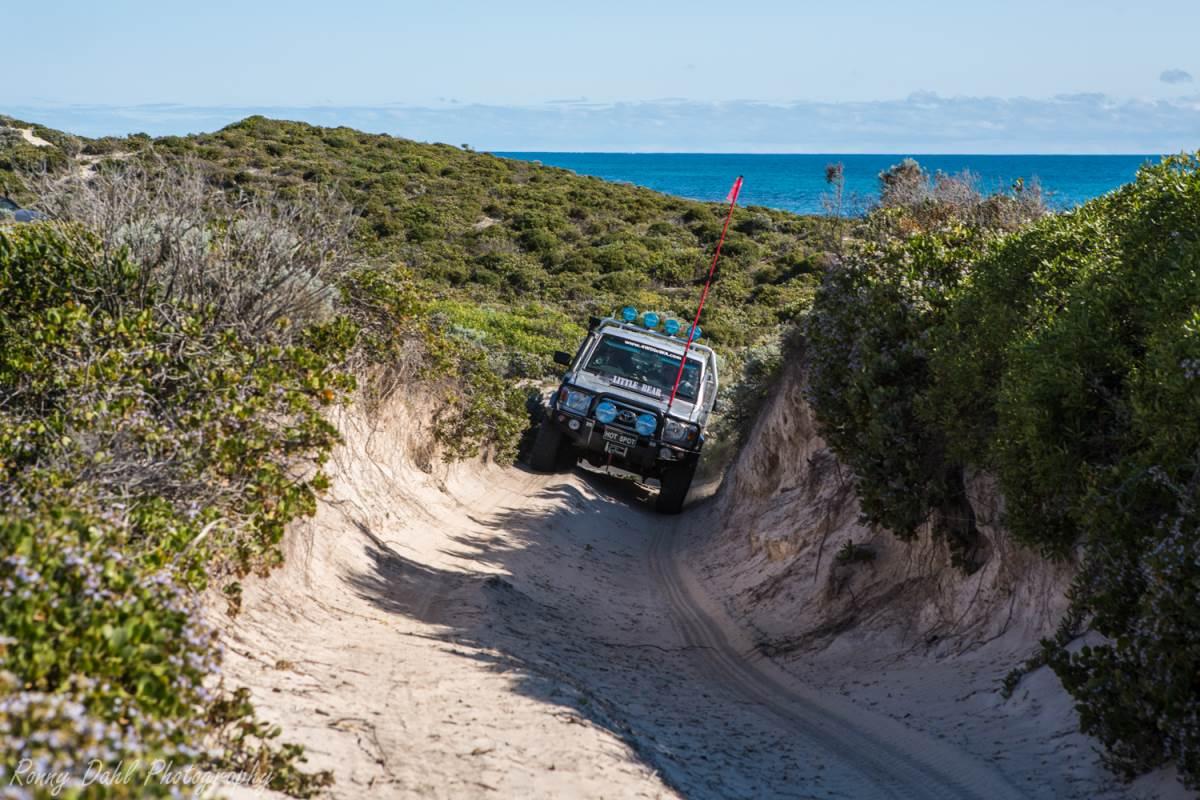 Toyota Land Cruiser on the sand track.