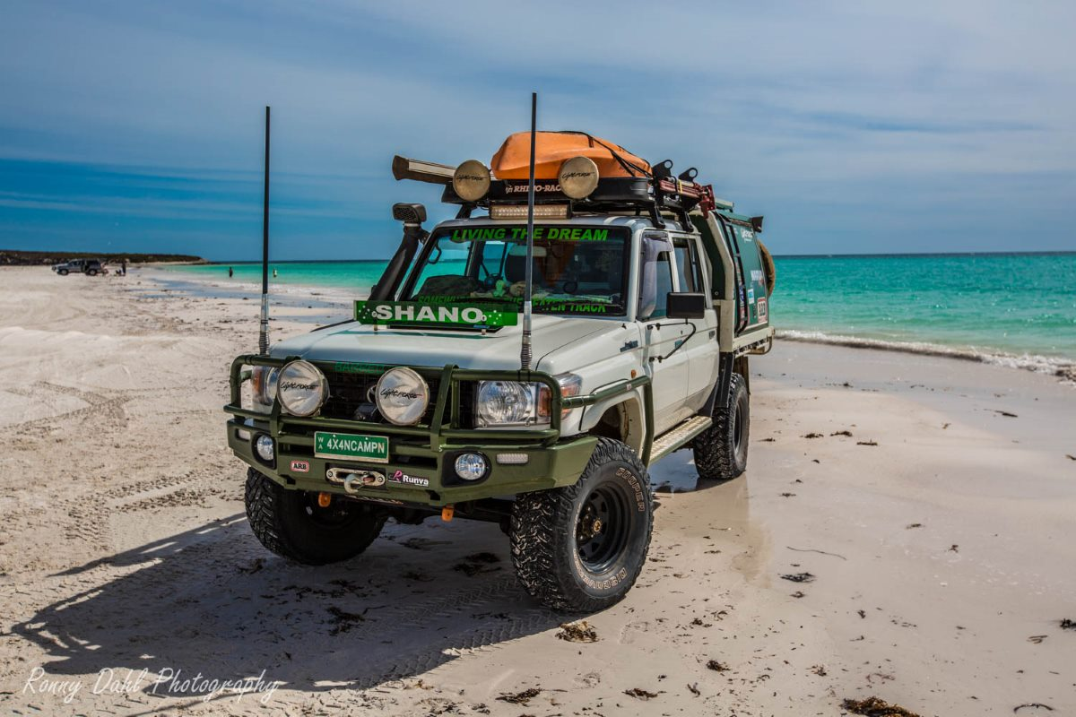 79 Series Landcruiser on beach.