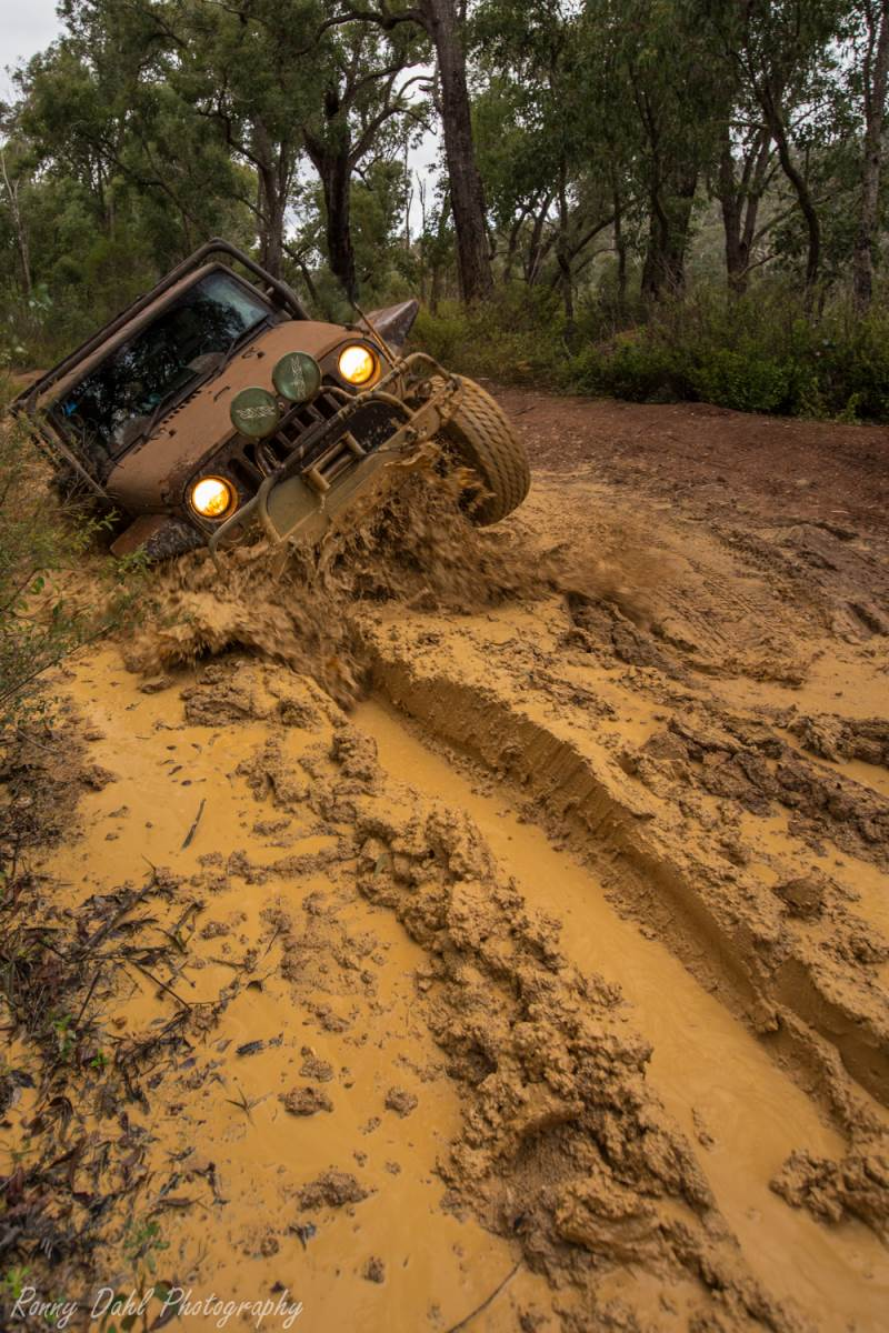 A Jeep not holding back in the mud.
