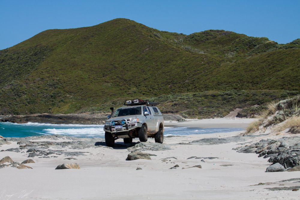 Hilux On Rock, Peaceful Bay Gap beach. Western Australia.