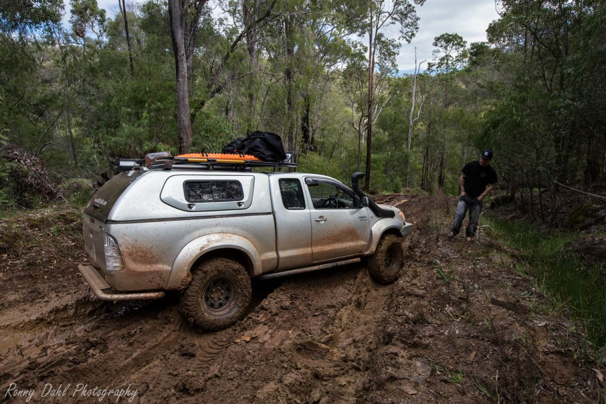 Toyota Hilux cross rutted on a hill descent.