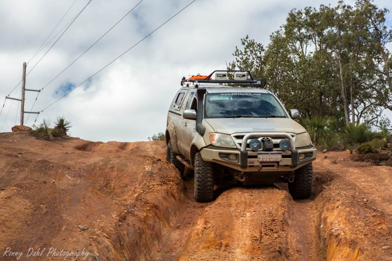 Hilux on Rutted track.