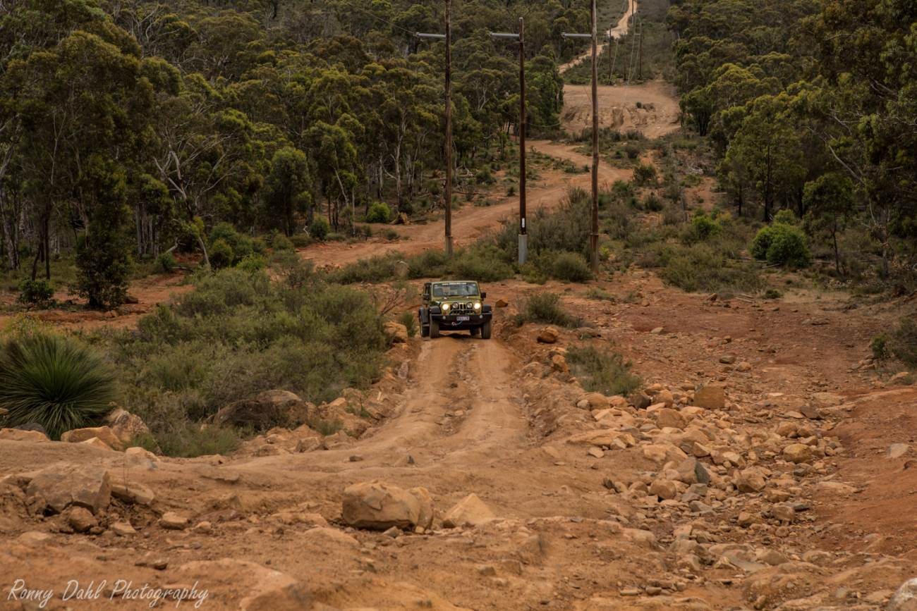 Jeep Wrangler climbing clay and rocky track.