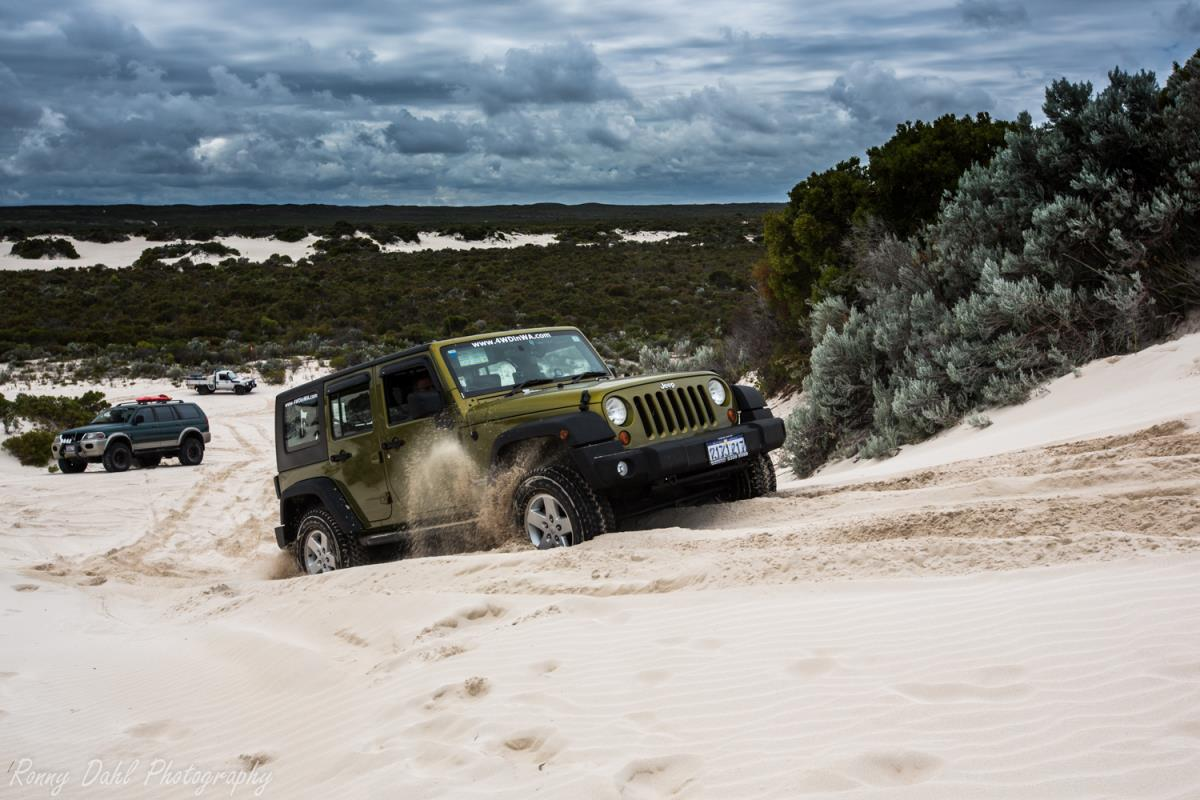 Jeep Wrangler having a play in the sand dunes at Cervantes, Western Australia.