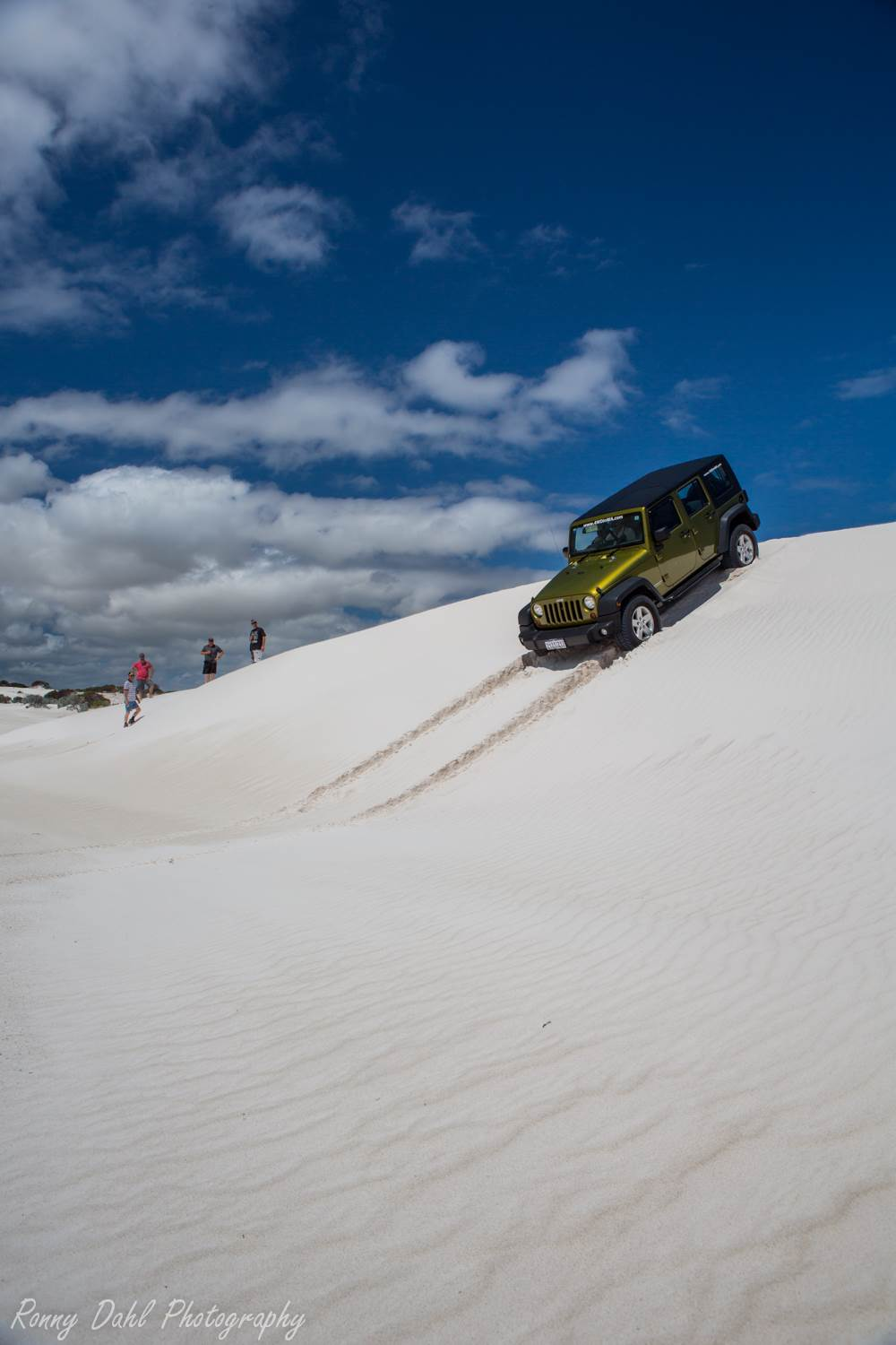 Jeep Wrangler having a play in the sand dunes at Wedge Island, WA.