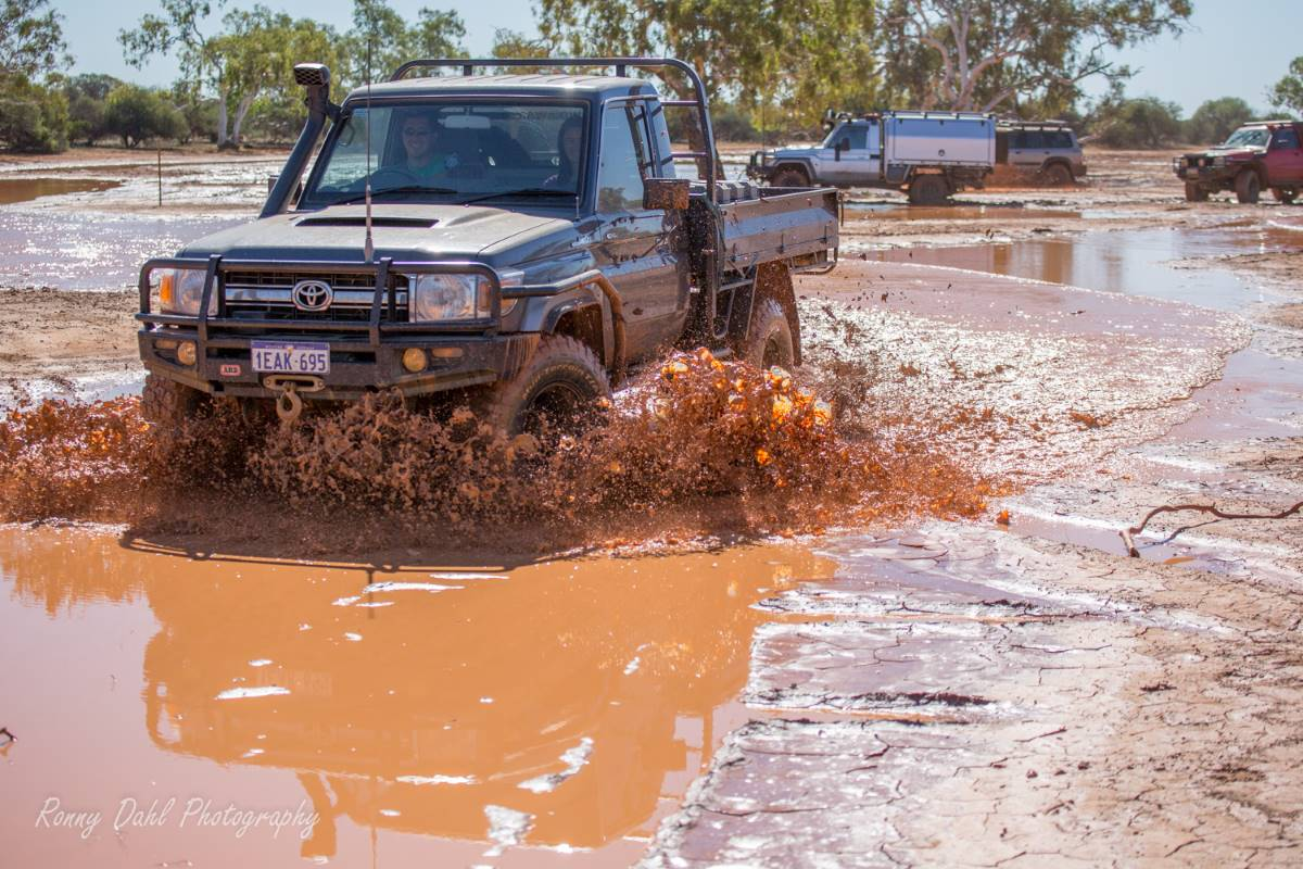 Toyota Landcruiser in the mud.