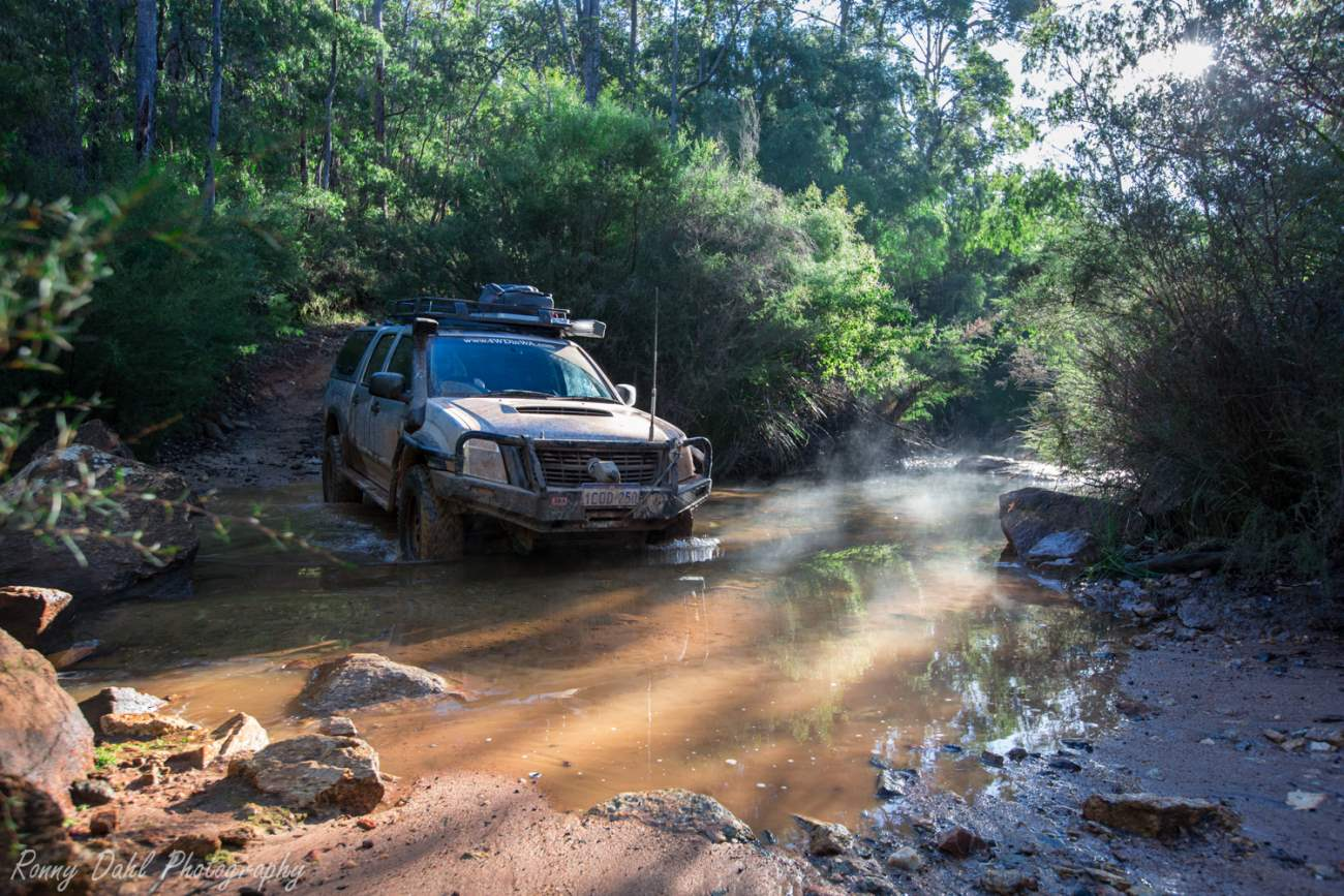 Holden Rodeo crossing a creek.