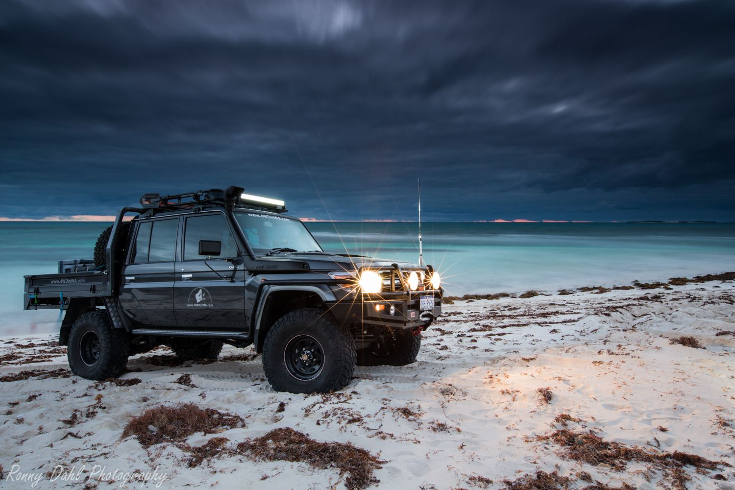 Toyota 79 Series Land Cruiser at sunset.
