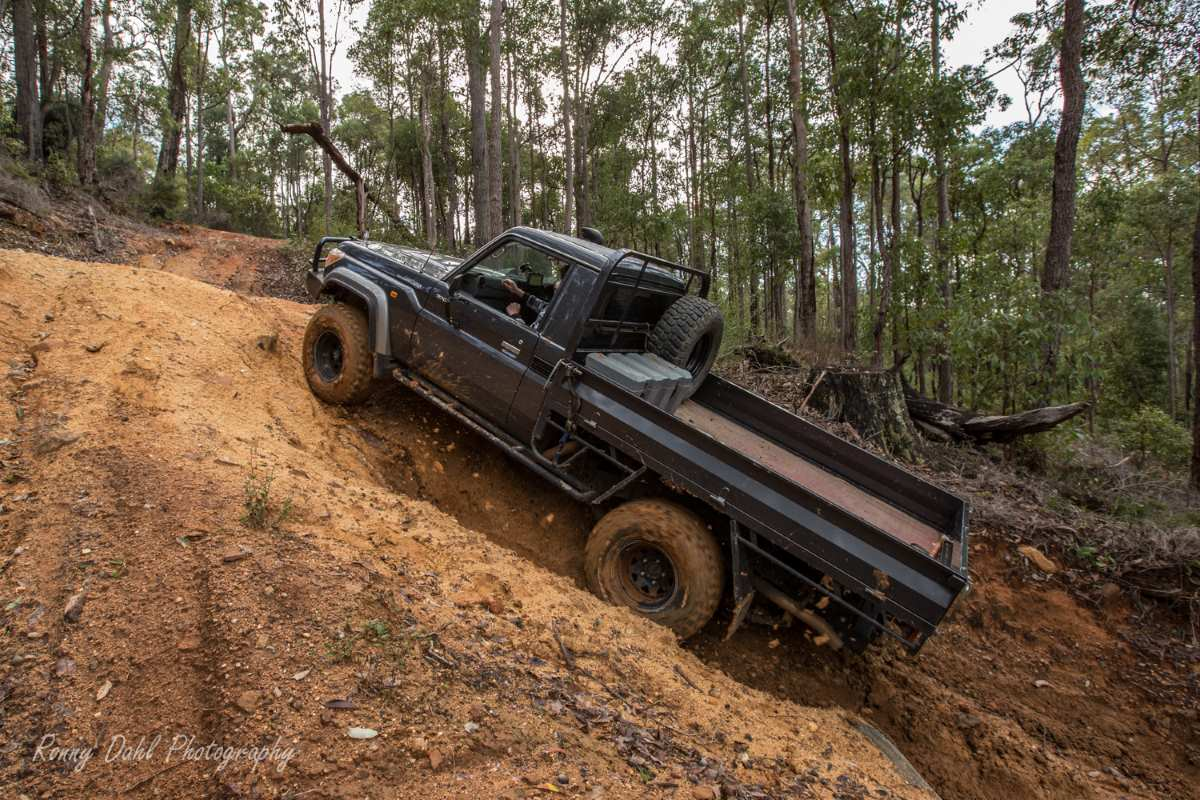 79 Series Land Cruiser climbing a steep hill.