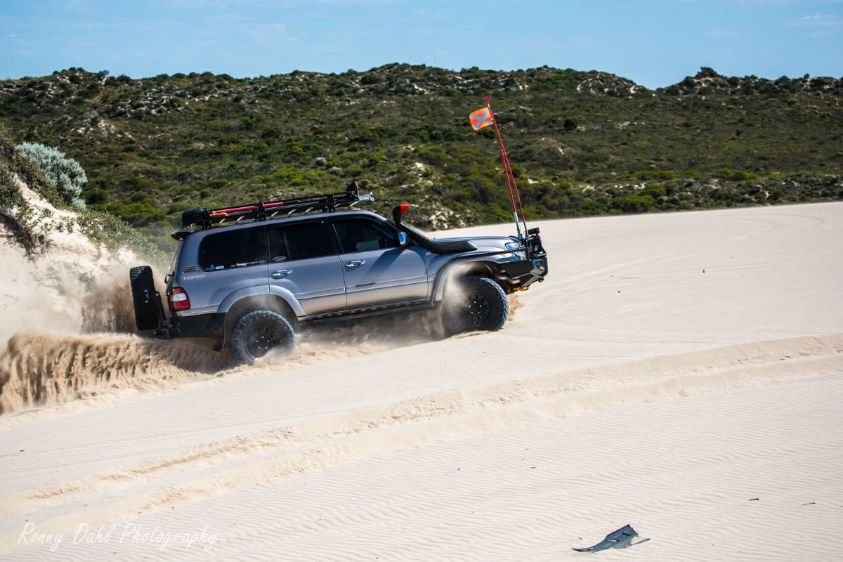 Toyota Land Cruiser 100 Series in the sand dunes.