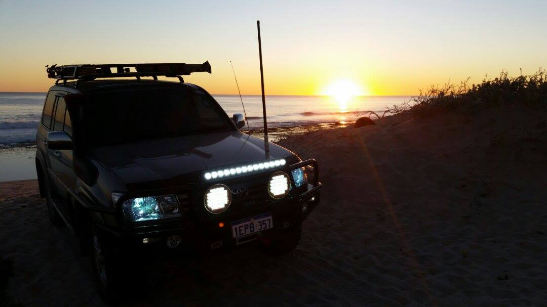 Toyota Land Cruiser 100 Series in the sunset.