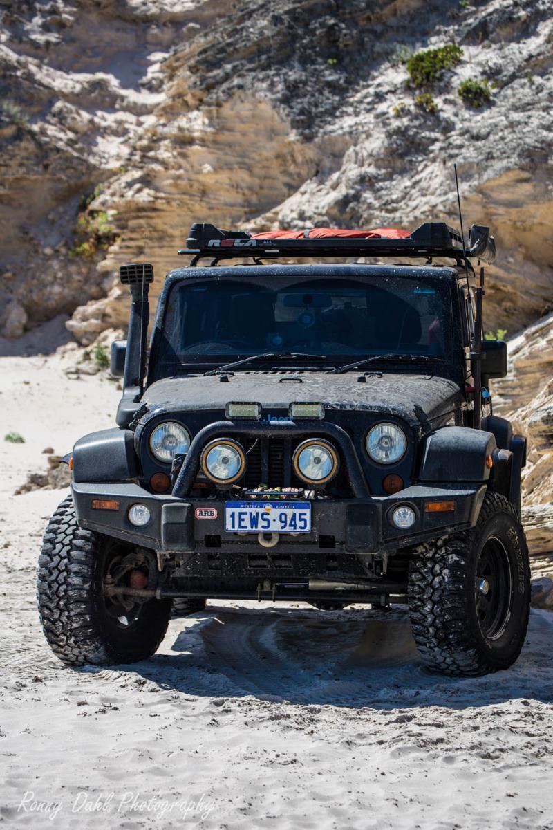 A Jeep JK Wrangler on the beach in Western Australia.