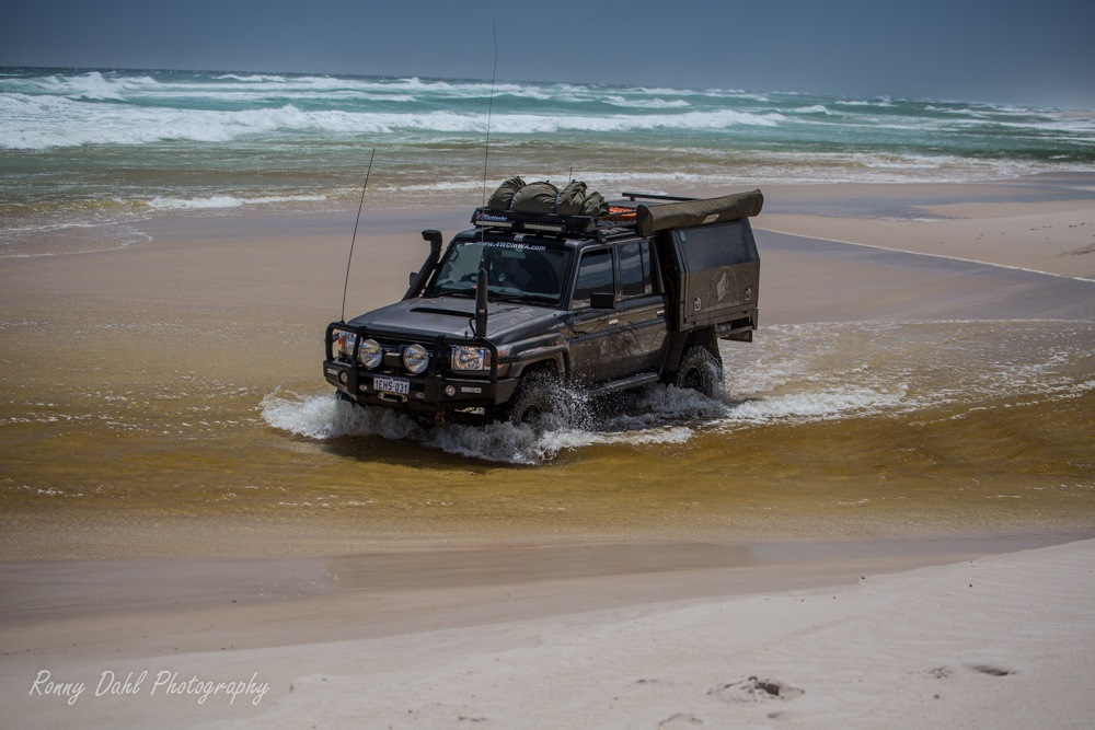79 series Toyota Land Cruiser crossing the Warren River, Western Australia.