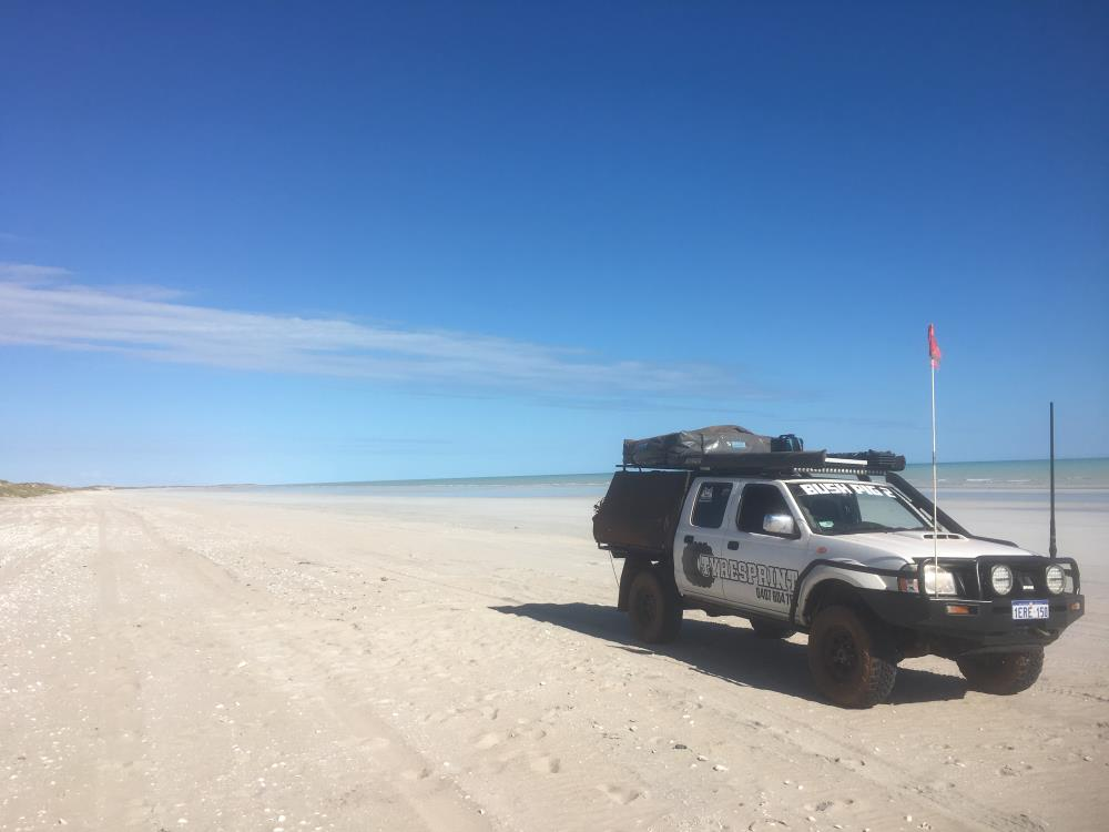 Nissan Navara D22, modified, on the beach.