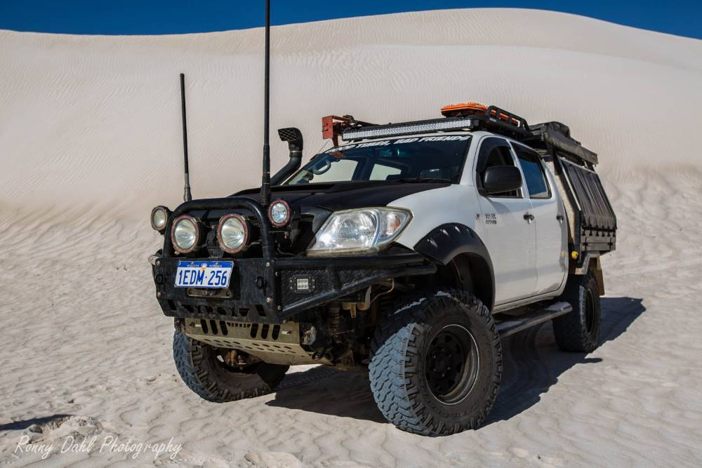A Toyota Hilux SR in the sand dunes.