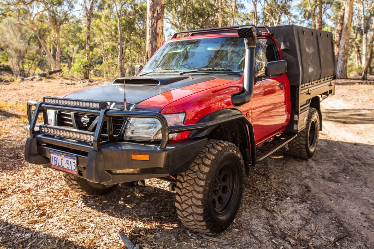 Red Nissan GU Patrol.