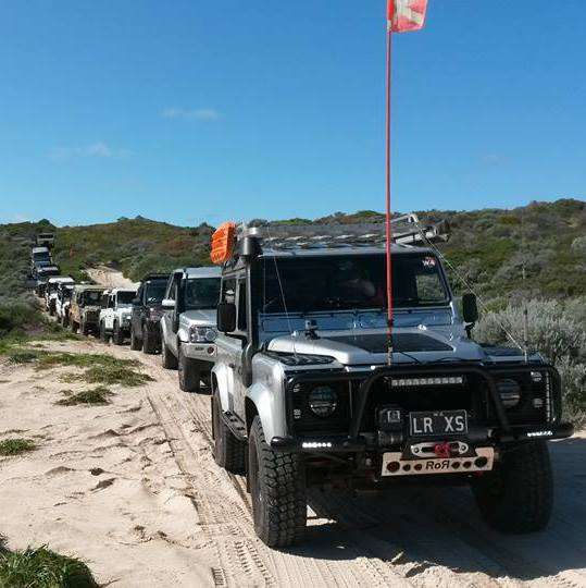 Land Rover's in convoy.