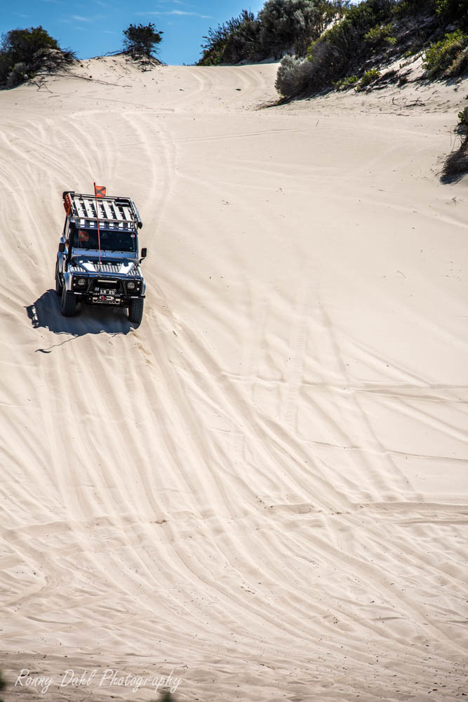 Land Rover Defender in the sand dunes.