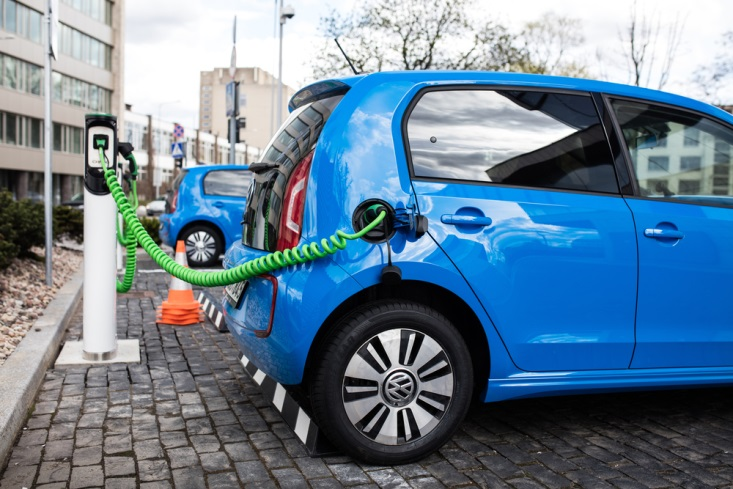 An electric car getting loaded with power.