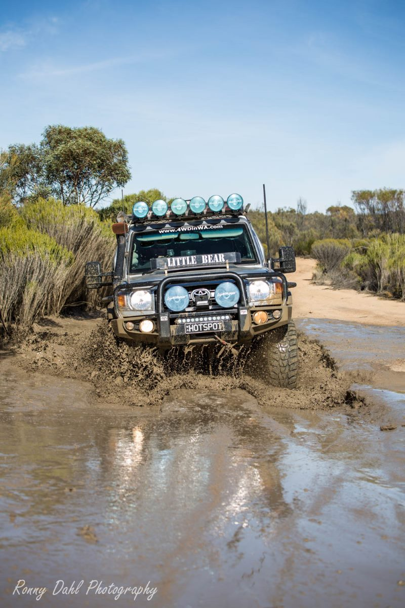 79 Series Land Cruiser  in the mud on the Holland Track, Western Australia.