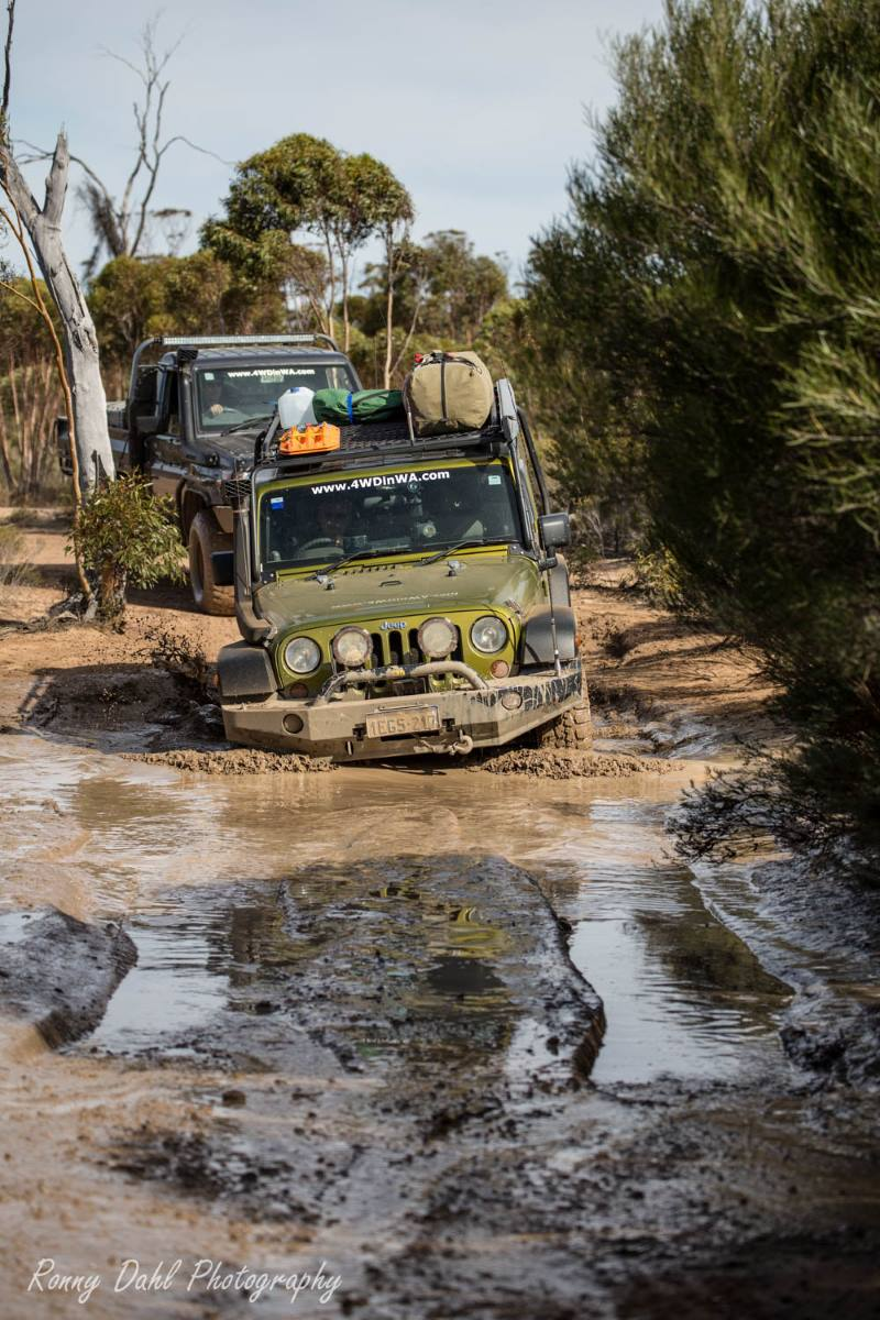 Jeep Wrangler JKU in the mud on the Holland Track, Western Australia.