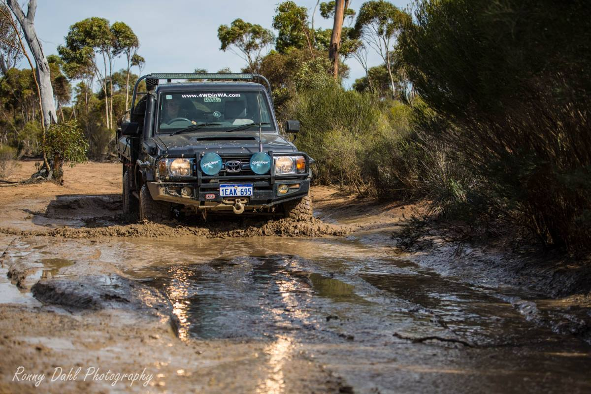 Toyota 79 Series Landcruiser in the mud on the Holland Track, Western Australia.