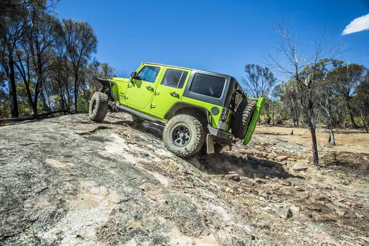 A Jeep Wrangler Climbing The Rock.