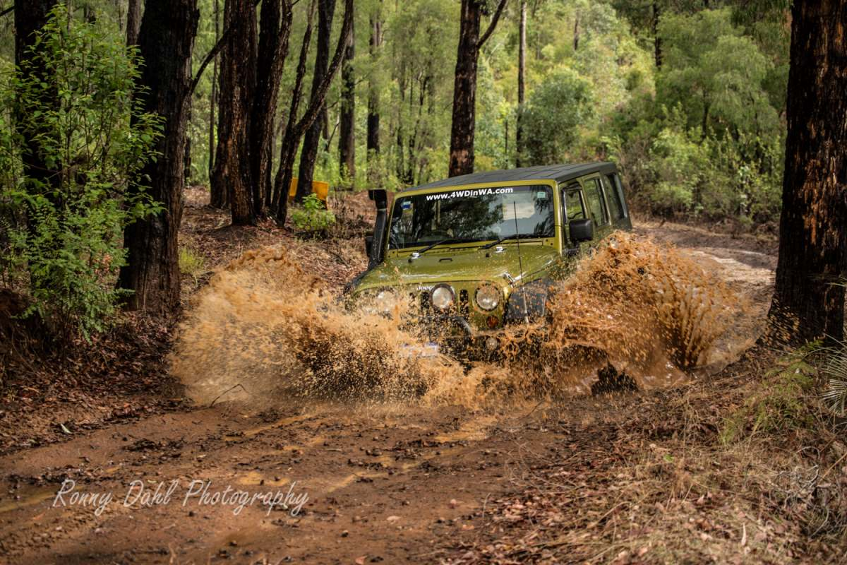 Jeep Wrangler splashing water.