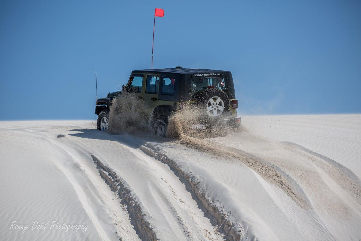 Jeep Wrangler stuck on sand dune.