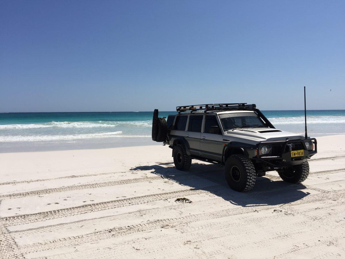 1993 Nissan GQ Patrol on the beach.