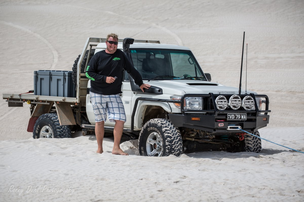Toyota Landcruiser stuck on sand dune.
