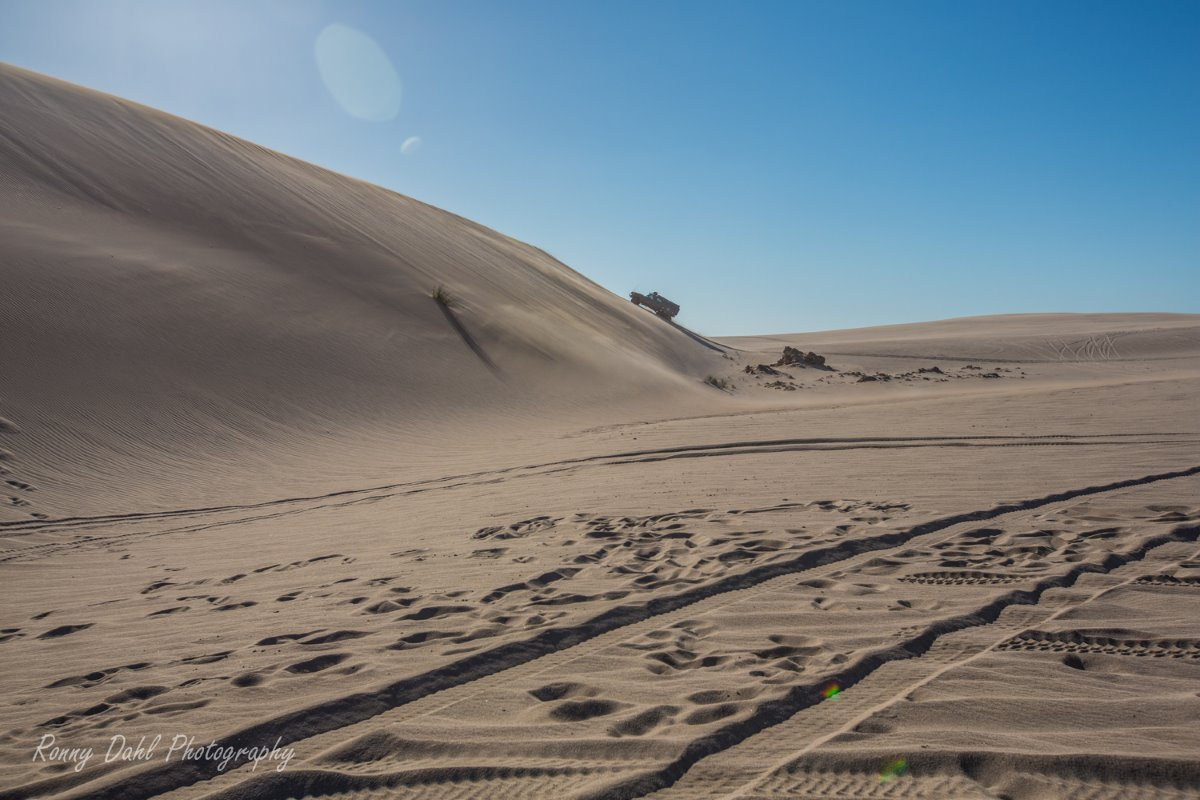 Driving in the sand dunes.