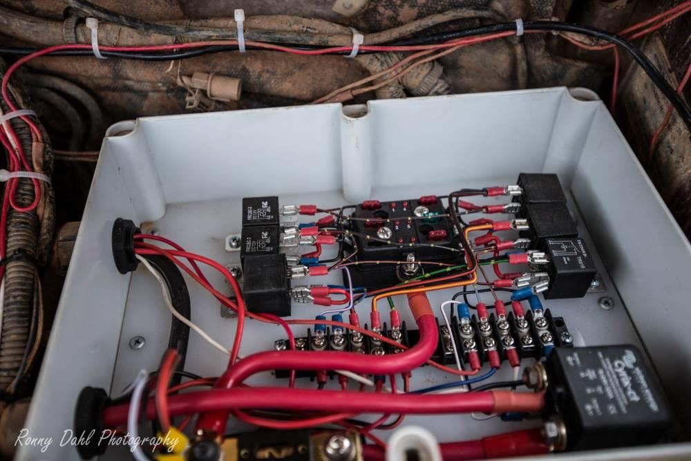 The fully custom fuse/relay box in the engine bay in the Mitsubishi Pajero NJ.