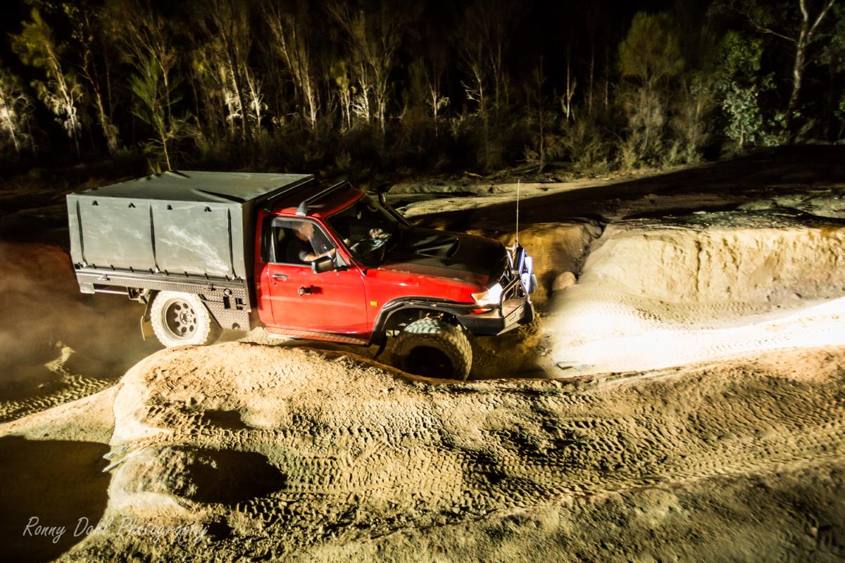 Nissan Patrol at night on the Powerline track.