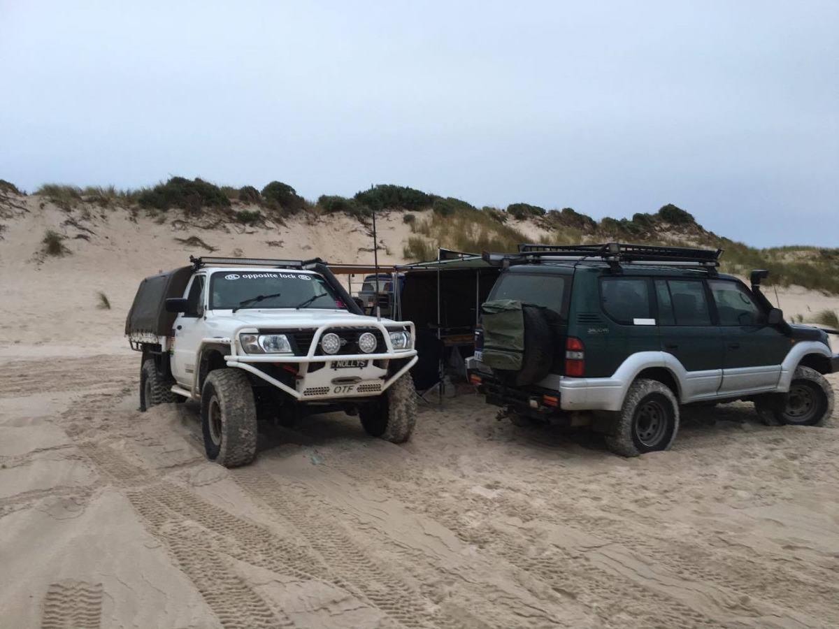 Nissan GU Patrol camping on the beach.