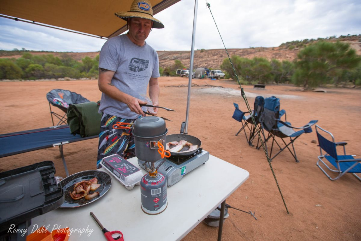 Cooking breakfast in the outback.