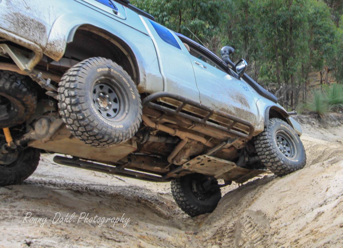 Rock sliders and underbody bash plates on Toyota Hilux.