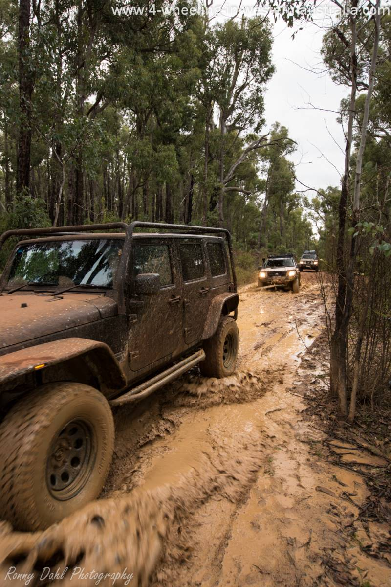 Snatching the 4x4 out of the mud.