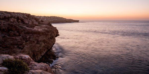 Sunset at False Entrance rock cliff fishing.