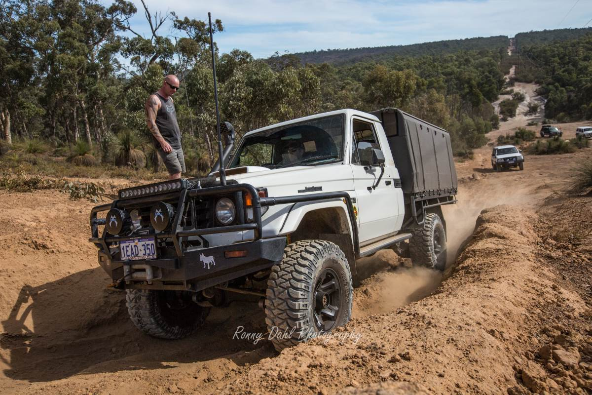 Toyota 79 series Land Cruiser on the Mundaring power line track. Western Australia.