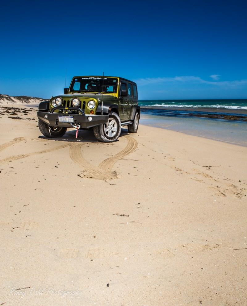 Jeep Wrangler at Wilbinga beach, Western Australia.